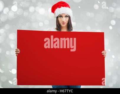 Santa Women, with red board - Stock Image