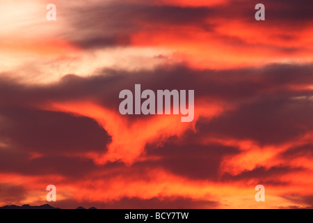 red clouds in morning sky - Stock Image