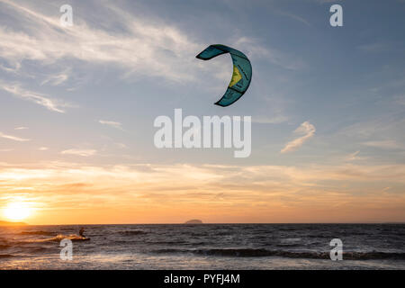 Kite Surfing with a beautiful sunset at Weston super Mare. - Stock Image