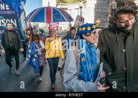 London, UK. 9th Dec, 2018. A united counter demonstration by anti-fascists marches in opposition to Tommy Robinson's fascist pro-Brexit march. Marchers includied both pro-Brexiteers and remainers with a small group with EU flags among the thousands of marchers. The anti-fascists gathered at the BBC to to to a rally at Downing St. Police had issued conditions on both events designed to keep the two groups well apart. Credit: Peter Marshall/Alamy Live News - Stock Image