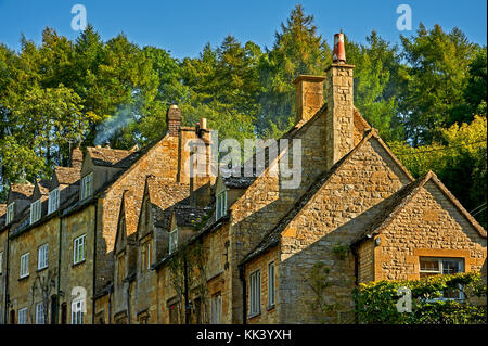 Cottages stepping up the hillside in the pretty Cotswold village of Snowshill - Stock Image