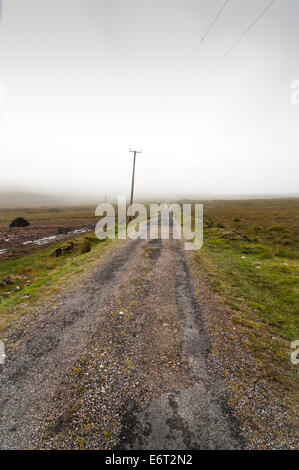 remote straight road on a misty day - Stock Image