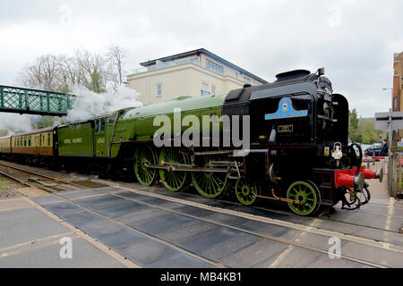 Tornado in Surrey. The Belmond 'Paddington Afternoon Tea Train' LNER A1 Class 4-6-2 no 60163 Tornado Steam Train speeds through Reigate, Surrey en route to Victoria, 1504hrs Saturday 7th April 2018. Photo by ©Lindsay Constable/Alamy Live News - Stock Image
