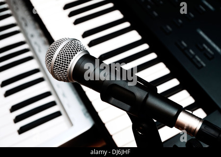 microphone and piano keyboards background - Stock Image