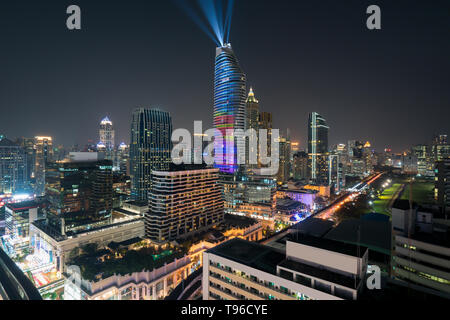 Night view with skyscraper in business district in Bangkok Thailand. Light show at Magnolias Ratchaprasong in Bangkok, Thailand. - Stock Image