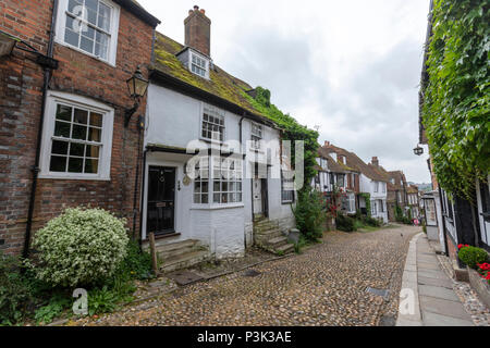 Mermaid Street showing typically steep slope and cobbled surface, Rye, East Sussex, England, UK - Stock Image