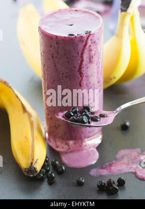 Homemade banana blueberry milkshake. - Stock Image