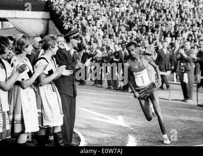 Oct 11, 1961; Kosice, Czechoslovakia; The 31st. annual International Peace Marathon took place last weekend in the East Slovak town of Kosice, Czechoslovakia. The event was won by BIKILA ABEBE of Ethiopia, with second Dr. Pavel Kantorek (CSSR) and in third place the Japanese long distance runner Nakao. In the picture, the winner Bikila Abebe arrives at the 'Locomotive' Stadium at the end of the event. - Stock Image