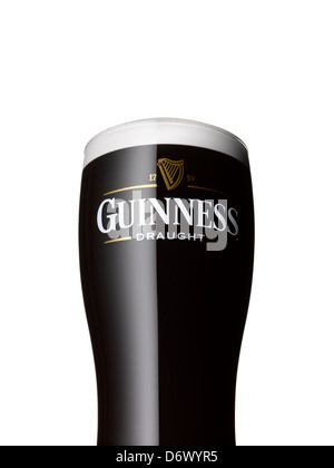 A close up shot of a pint of Guinness on a white background - Stock Image