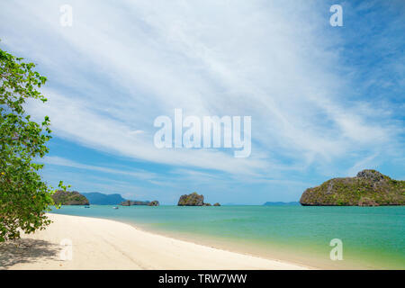 Tropical beach with bright sand and deep blue sea. Summer sea vacation and travel concept - Stock Image
