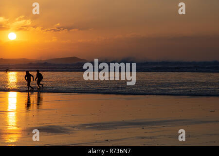 Winter evening sunshine on the beach at Watergate Bay, Newquay, Cornwall - Stock Image