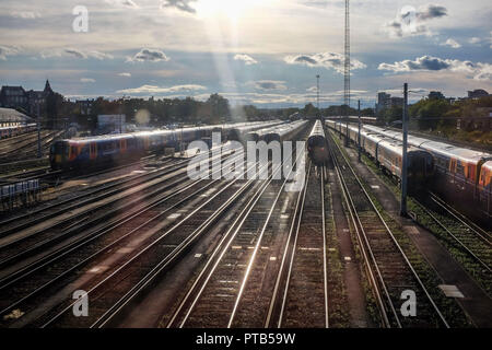 South Western Railways trains at Clapham Junction Railway Station in London UK - Stock Image