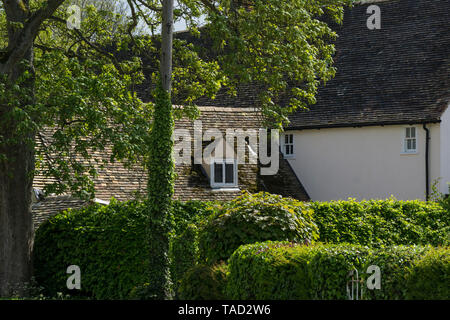 Small window in roof old manor house Milton 2019 - Stock Image