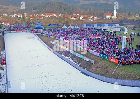 Outran of Ski Jumping Hill and cheering fan audiance during World Cup competition for ladies in Ljubno ob Savinji - Stock Image