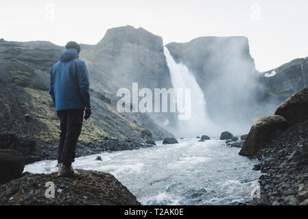 Hiker by Haifoss waterfall in Iceland - Stock Image