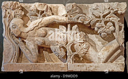 Medieval lintel carved of limestone by Gislebertus in around 1130 AD depicting the Tempation of Eve in Rolin Museum - Stock Image