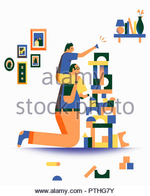 Father and son having fun playing with building blocks - Stock Image