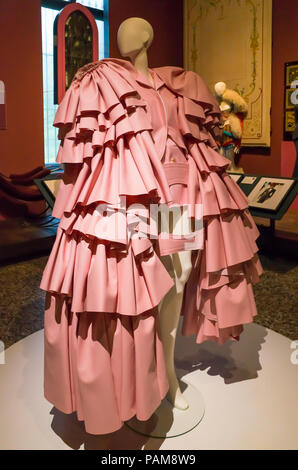 Display of a elaborate pink dress from the Comme des Garçons collection autumn winter 2016  at the Catwalk Exhibition at the Bowes Museum 2018 - Stock Image