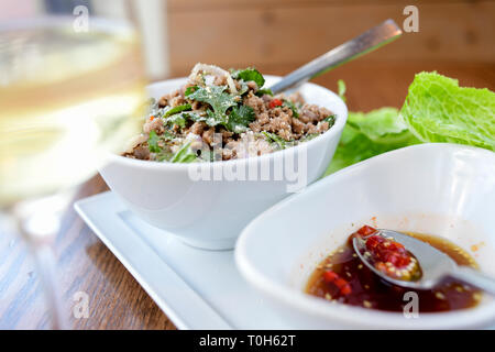 Food Thai dish Larb with pork and a hot chili sauce - Stock Image