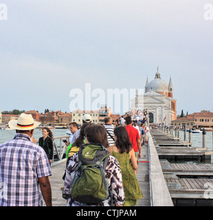 People crossing the pontoon bridge over the Giudecca Canal at Festa del Redentore 2012, Venice, Italy - Stock Image