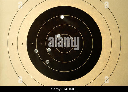 Paper Target with Five bullet Holes, USA - Stock Image