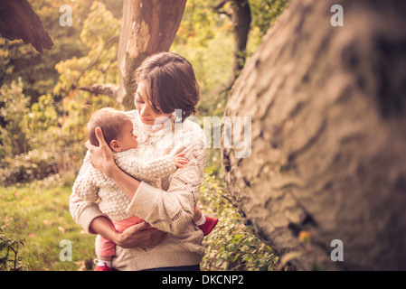 Mother and baby enjoying park - Stock Image