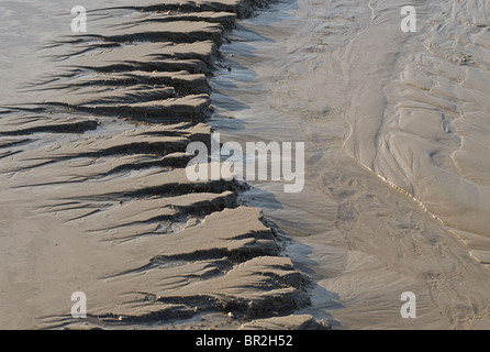 Detail of miniature gulleys in the sand, Brighton beach - Stock Image