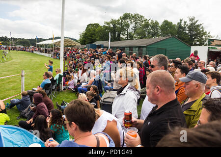 Stirling, Scotland, UK. 5th August 2018. Spectators around the main show ring at Strathallan Games Park near Stirling, the venue for the 167th Bridge of Allan Highland Games.  Crowds have gathered to watch highland dancing, the pipe band competion, athletics, cycle racing and the traditional heavywight contests including tossing the caber.  Credit Joseph Clemson, JY News Images/Alamy Live News. - Stock Image