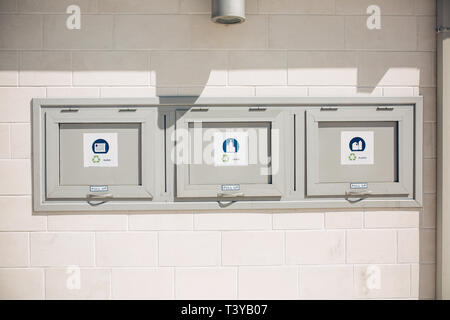 Separate waste sorting. Modern garbage cans to collect glass, plastic and paper. - Stock Image