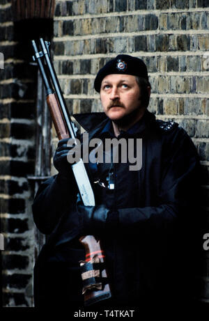 British Police armed with guns. 1986 Photographs from a series photographed in 1986 showing the arming of the British Police, traditionally at the time not armed.Special armed police guard Lambeth Magistrates Court in London during an IRA trial. Seen using a Remington shot gun. - Stock Image