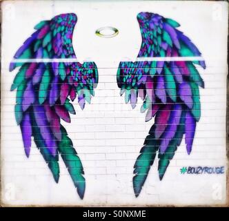 Street art painting of angels wings and halo - Stock Image