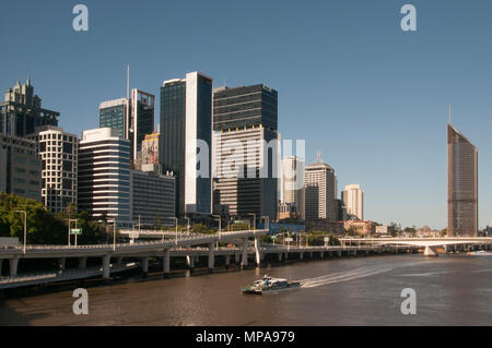 CBD office towers loom above the Riverside Expressway, Brisbane, Queensland, Australia - Stock Image