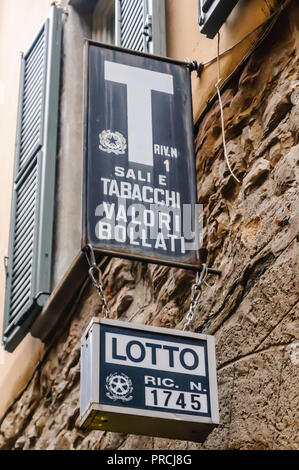 Sign above an Italian tobacconist's shop, Citta Alta, Bergamo, Italy - Stock Image