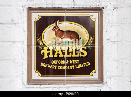Halls Brewery Sign on Red Lion pub wall. Theale, Berkshire, England, GB, UK. - Stock Image