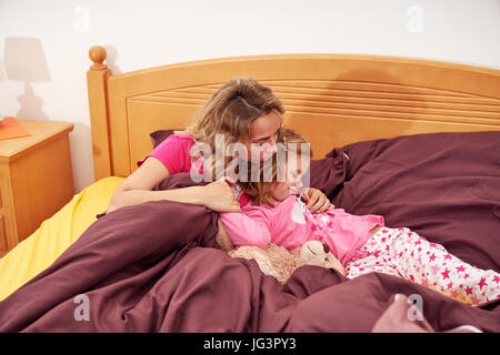 Mother and daughter indoors at home - Stock Image