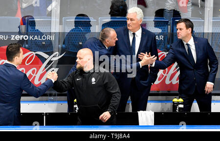 Bratislava, Slovakia. 19th May, 2019. Czech head coach Milos Riha, second from right, and his assistants Robert Reichel, third from right, Karel Mlejnek, right, at the bench celebrate victory in the match between Austria and Czech Republic within the 2019 IIHF World Championship in Bratislava, Slovakia, on May 19, 2019. Credit: Vit Simanek/CTK Photo/Alamy Live News - Stock Image