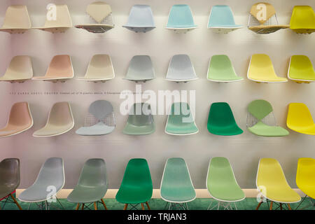 MILAN, ITALY - APRIL 11, 2019: Milan Design Week, Eames chairs Vitra installation and exhibition during Salone del Mobile in Milan, Italy. - Stock Image