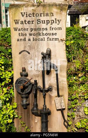 UK, England, Devon, Okehampton, old Victorian Workhouse water supply pump - Stock Image