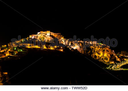 The town of Salobrena on the Costa Tropical of Granada Province, Spain with its Moorish castle atop the hill illuminated at night. - Stock Image
