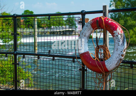An old Life-belt at Hambleden Lock near Henley, England. Over looking a weir on the River Thames on a sunny late - Stock Image