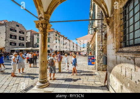 The main street, Stradun or Placa in Old Town Dubrovnik Croatia on a sunny day with crowds of tourists enjoying the summer heat - Stock Image