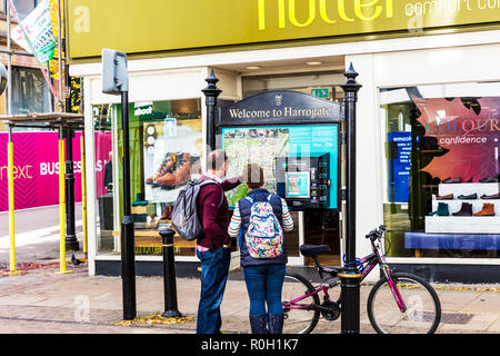 Harrogate town Centre, Yorkshire UK England, Welcome to Harrogate sign, City maps Harrogate, Looking at city map, working out directions, Harrogate UK - Stock Image