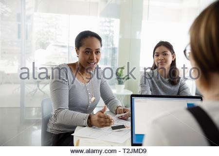 Female interior designers meeting in office - Stock Image