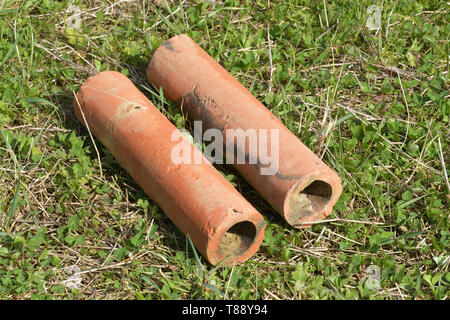 Clay field drainage pipes.Found in a field while digging a pond  in Somerset. Probably Victorian as this was the era during which many thousands of ac - Stock Image