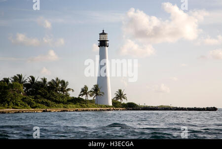 Cape Florida Light as viewed from the Biscayne Channel on a sultry summer's day, the image taken from a boat. - Stock Image