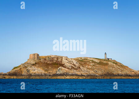 The fort and lighthouse in Moines Island, Ile aux Moines, Sept-Iles archipelago Cotes d'Armor, Brittany, France. - Stock Image