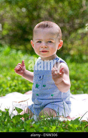 Cute baby boy outside - Stock Image