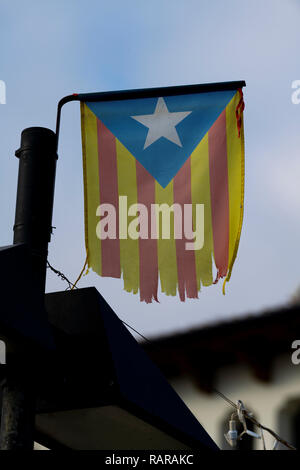 La Senyera Estelada is the  flag waved by supporters seeking Catalonia's independence from Spain . - Stock Image