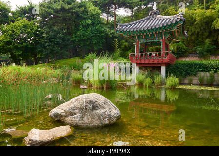 Small pond with chinese style band stand near Seoul World Cup Stadium, South Korea. - Stock Image