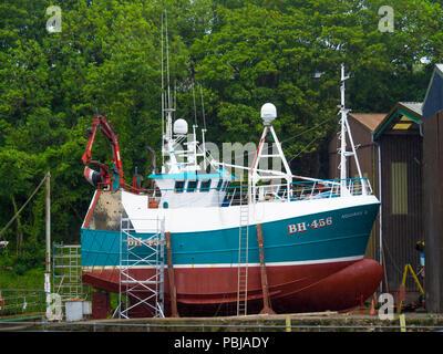Trawler BH456 AQUARIUS II built in Norway in 1980, seen here in dock for overhaul in Eyemouth Berwickshire Scotland - Stock Image